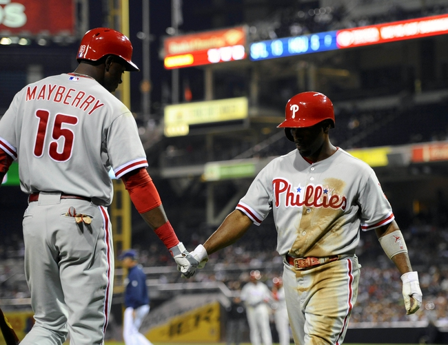 June 25, 2013; San Diego, CA, USA; Philadelphia Phillies shortstop Jimmy Rollins (11) is congratulated by right fielder John Mayberry Jr. (15) after scoring on a bases-loaded walk during the fifth inning against the San Diego Padres at Petco Park. Mandatory Credit: Christopher Hanewinckel-USA TODAY Sports