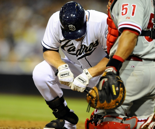 June 25, 2013; San Diego, CA, USA; San Diego Padres third baseman Chase Headley (7) reacts after striking out on a called strike three during the sixth inning against the Philadelphia Phillies at Petco Park.  Mandatory Credit: Christopher Hanewinckel-USA TODAY Sports