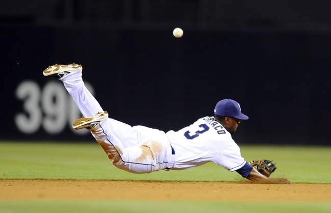 June 25, 2013; San Diego, CA, USA; San Diego Padres shortstop Pedro Ciriaco (3) misses a ground ball on a dive attempt during the eighth inning against the Philadelphia Phillies at Petco Park.  Mandatory Credit: Christopher Hanewinckel-USA TODAY Sports