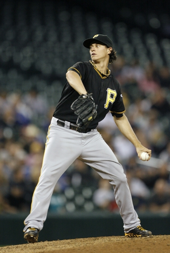 Jun 25, 2013; Seattle, WA, USA; Pittsburgh Pirates pitcher Jeff Locke (49) throws against the Seattle Mariners during the fifth inning at Safeco Field. Mandatory Credit: Joe Nicholson-USA TODAY Sports