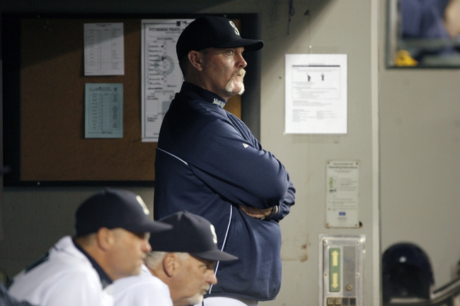 Jun 25, 2013; Seattle, WA, USA; Seattle Mariners manager Eric Wedge (22) watches play against the Pittsburgh Pirates during the fifth inning at Safeco Field. Mandatory Credit: Joe Nicholson-USA TODAY Sports