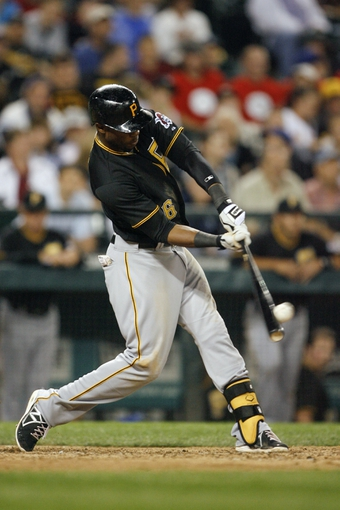 Jun 25, 2013; Seattle, WA, USA; Pittsburgh Pirates left fielder Starling Marte (6) hits a solo home run against the Seattle Mariners during the eighth inning at Safeco Field. Mandatory Credit: Joe Nicholson-USA TODAY Sports