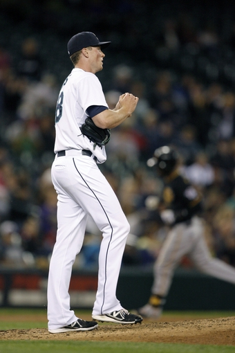 Jun 25, 2013; Seattle, WA, USA; Seattle Mariners pitcher Carter Capps (58) looks to the scoreboard after surrendering a solo home run against the Pittsburgh Pirates during the eighth inning at Safeco Field. Mandatory Credit: Joe Nicholson-USA TODAY Sports