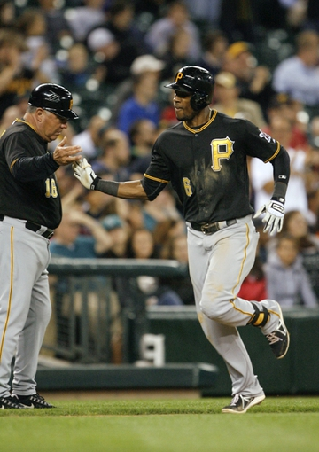 Jun 25, 2013; Seattle, WA, USA; Pittsburgh Pirates left fielder Starling Marte (6) gets a high-five from third base coach Nick Leyva (16) after hitting a solo home run against the Seattle Mariners during the eighth inning at Safeco Field. Mandatory Credit: Joe Nicholson-USA TODAY Sports