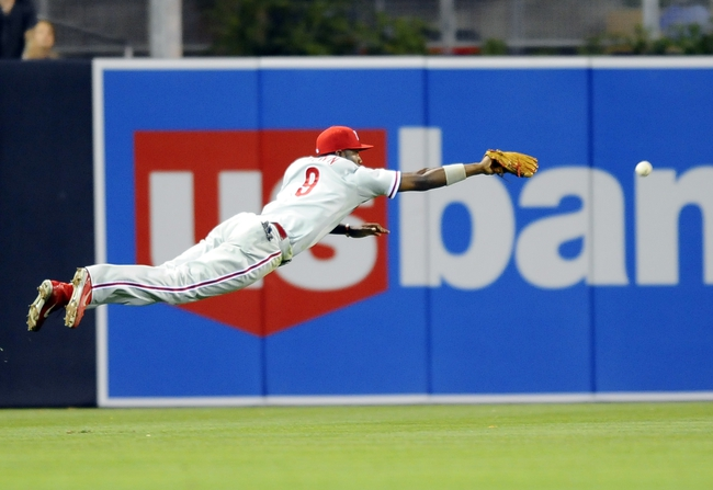 June 25, 2013; San Diego, CA, USA; Philadelphia Phillies left fielder Domonic Brown (9) misses on a diving attempt during the ninth inning against the San Diego Padres at Petco Park. Mandatory Credit: Christopher Hanewinckel-USA TODAY Sports