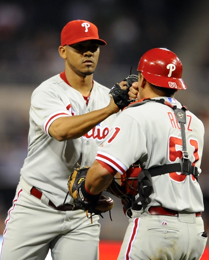 June 25, 2013; San Diego, CA, USA; Philadelphia Phillies relief pitcher Antonio Bastardo (59) celebrates with catcher Carlos Ruiz (51) after a 6-2 win against the San Diego Padres at Petco Park. Mandatory Credit: Christopher Hanewinckel-USA TODAY Sports