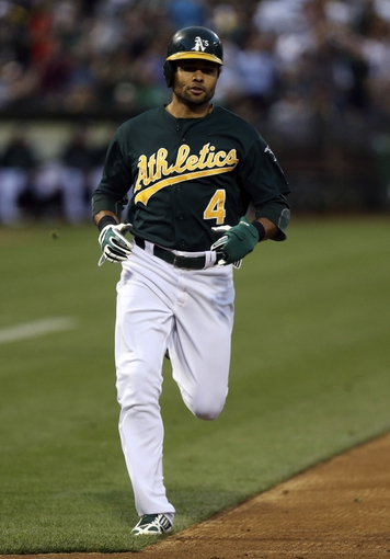 Jun 25, 2013; Oakland, CA, USA; Oakland Athletics center fielder Coco Crisp (4) scores a run against the Cincinnati Reds during the fourth inning at O.co Coliseum. Mandatory Credit: Kelley L Cox-USA TODAY Sports