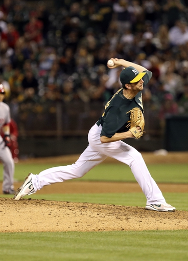 Jun 25, 2013; Oakland, CA, USA; Oakland Athletics relief pitcher Jerry Blevins (13) pitches the ball against the Cincinnati Reds during the sixth inning at O.co Coliseum. The Oakland Athletics defeated the Cincinnati Reds 7-3. Mandatory Credit: Kelley L Cox-USA TODAY Sports
