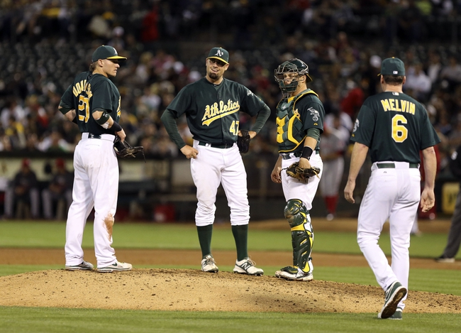 Jun 25, 2013; Oakland, CA, USA; Oakland Athletics relief pitcher Pat Neshek (47) is removed from the game by manager Bob Melvin (6) against the Cincinnati Reds during the sixth inning at O.co Coliseum. The Oakland Athletics defeated the Cincinnati Reds 7-3. Mandatory Credit: Kelley L Cox-USA TODAY Sports