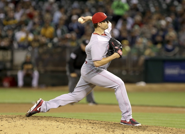 Jun 25, 2013; Oakland, CA, USA; Cincinnati Reds relief pitcher Manny Parra (43) pitches the ball against the Oakland Athletics during the seventh inning at O.co Coliseum. The Oakland Athletics defeated the Cincinnati Reds 7-3. Mandatory Credit: Kelley L Cox-USA TODAY Sports