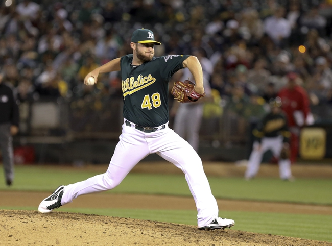 Jun 25, 2013; Oakland, CA, USA; Oakland Athletics relief pitcher Ryan Cook (48) pitches the ball against the Cincinnati Reds during the seventh inning at O.co Coliseum. The Oakland Athletics defeated the Cincinnati Reds 7-3. Mandatory Credit: Kelley L Cox-USA TODAY Sports