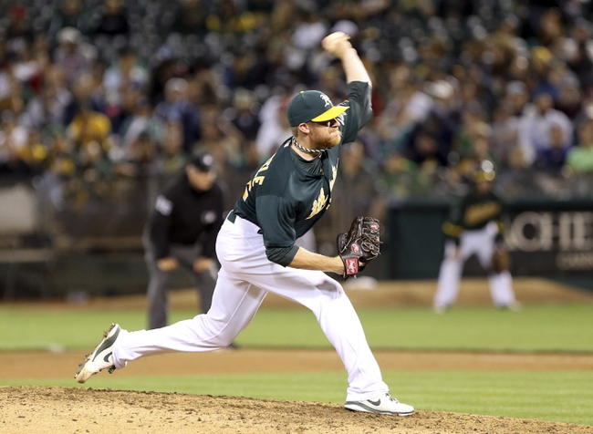 Jun 25, 2013; Oakland, CA, USA; Oakland Athletics relief pitcher Sean Doolittle (62) pitches the ball against the Cincinnati Reds during the eighth inning at O.co Coliseum. The Oakland Athletics defeated the Cincinnati Reds 7-3. Mandatory Credit: Kelley L Cox-USA TODAY Sports