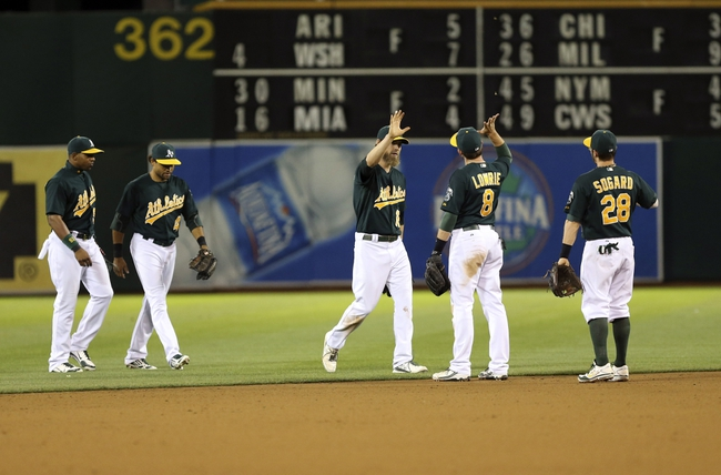 Jun 25, 2013; Oakland, CA, USA; Oakland Athletics celebrate after the win over the against the Cincinnati Reds at O.co Coliseum. The Oakland Athletics defeated the Cincinnati Reds 7-3. Mandatory Credit: Kelley L Cox-USA TODAY Sports