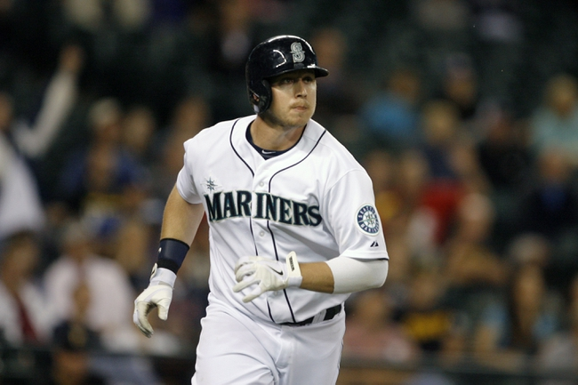 Jun 25, 2013; Seattle, WA, USA; Seattle Mariners first baseman Justin Smoak (17) watches his two-run home run go over the wall against the Pittsburgh Pirates during the ninth inning at Safeco Field. Mandatory Credit: Joe Nicholson-USA TODAY Sports