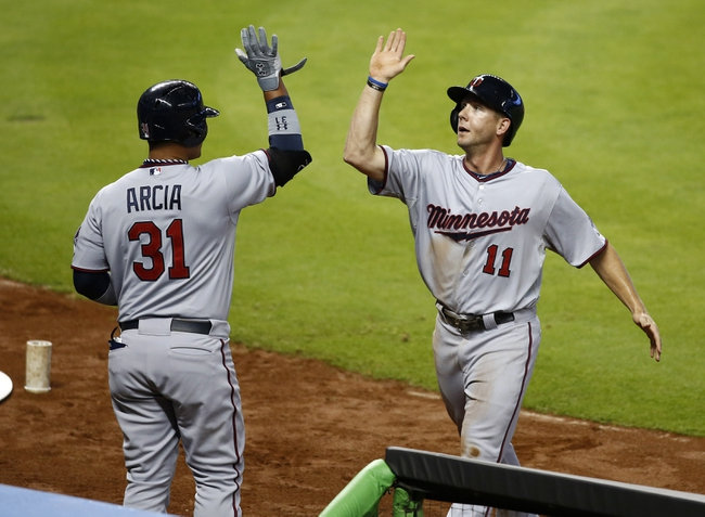 Jun 26, 2013; Miami, FL, USA;  Minnesota Twins center fielder Clete Thomas (11) gets congratulations from left fielder Oswaldo Arcia (31) after scoring against the Miami Marlins in the first inning at Marlins Park.  Mandatory Credit: Robert Mayer-USA TODAY Sports