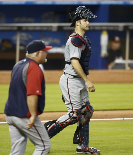 Jun 26, 2013; Miami, FL, USA;  Minnesota Twins catcher Joe Mauer (right) and manager Ron Gardenhire (front) walks to the mound for a pitching change in the eighth inning against the Miami Marlins at Marlins Park. The Marlins won 5-3. Mandatory Credit: Robert Mayer-USA TODAY Sports