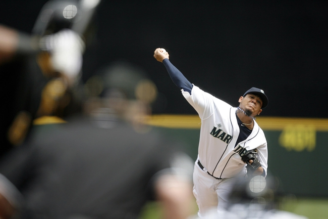 Jun 26, 2013; Seattle, WA, USA; Seattle Mariners pitcher Felix Hernandez (34) throws against the Pittsburgh Pirates during the first inning at Safeco Field. Mandatory Credit: Joe Nicholson-USA TODAY Sports