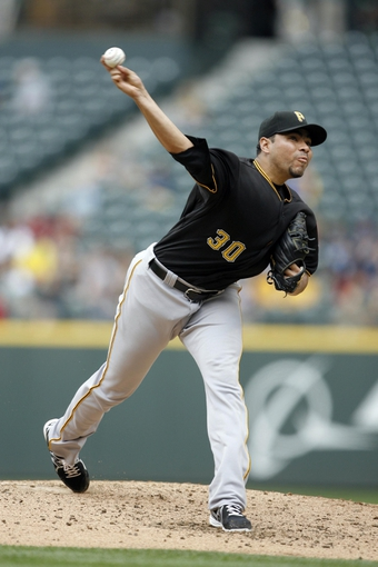 Jun 26, 2013; Seattle, WA, USA; Pittsburgh Pirates pitcher Jeanmar Gomez (30) throws against the Seattle Mariners during the second inning at Safeco Field. Mandatory Credit: Joe Nicholson-USA TODAY Sports