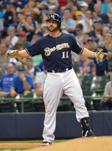 Jun 27, 2013; Milwaukee, WI, USA; Milwaukee Brewers pinch hitter Sean Halton reacts after getting his first major league hit in his first major league at bat in the 5th inning against the Chicago Cubs at Miller Park. Mandatory Credit: Benny Sieu-USA TODAY Sports