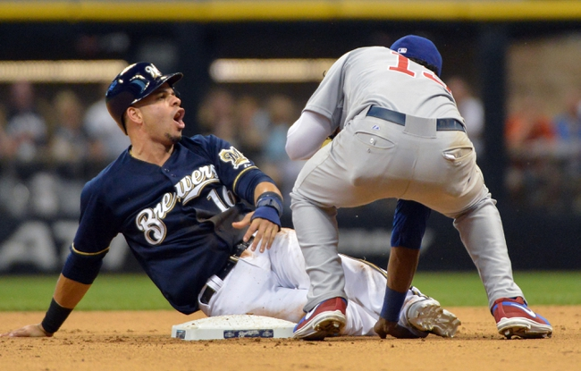 Jun 27, 2013; Milwaukee, WI, USA;  Milwaukee Brewers third baseman Aramis Ramirez reacts after he was called out trying to steal 2nd base in the 6th inning after Chicago Cubs shortstop Starlin Castro applied the tag at Miller Park. Mandatory Credit: Benny Sieu-USA TODAY Sports