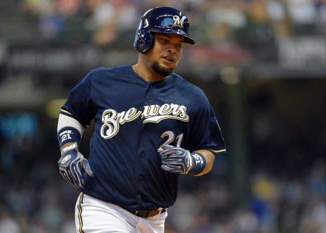 Jun 27, 2013; Milwaukee, WI, USA; Milwaukee Brewers first baseman Juan Francisco runs the bases after hitting a solo home run in the 8th inning against the Chicago Cubs at Miller Park. Mandatory Credit: Benny Sieu-USA TODAY Sports