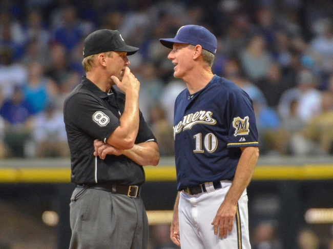 Jun 27, 2013; Milwaukee, WI, USA;  Milwaukee Brewers manager Ron Roenicke argues a call by umpire Jeff Kellogg in the 6th inning during the game against the Chicago Cubs at Miller Park. Mandatory Credit: Benny Sieu-USA TODAY Sports
