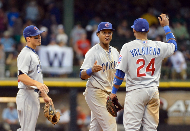 Jun 27, 2013; Milwaukee, WI, USA; Chicago Cubs second baseman Darwin Barney (left), shortstop Starlin Castro (center) and third baseman Luis Valbuena celebrate after beating the Milwaukee Brewers 7-2 at Miller Park. Mandatory Credit: Benny Sieu-USA TODAY Sports