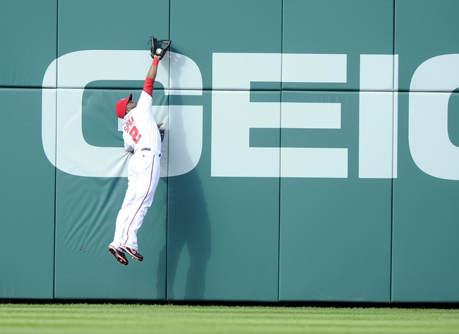 Jun 27, 2013; Washington, DC, USA; Washington Nationals center fielder Denard Span (2) makes a leaping catch of a Arizona Diamondbacks left fielder Jason Kubel (not shown) fly ball during the second inning at Nationals Park.  Mandatory Credit: Brad Mills-USA TODAY Sports