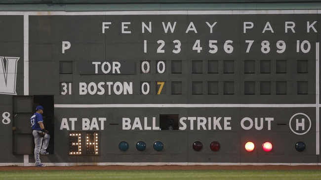 Jun 27, 2013; Boston, MA, USA;  Toronto Blue Jays left fielder Melky Cabrera takes a look inside the scoreboard during a pitching change after they gave up seven runs to the Boston Red Sox during the second inning at Fenway Park. Mandatory Credit: Winslow Townson-USA TODAY Sports
