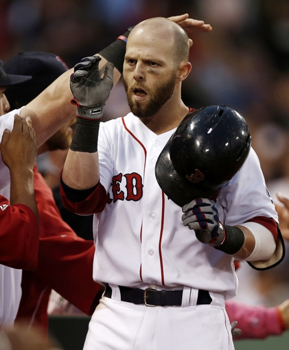 Jun 27, 2013; Boston, MA, USA;  Boston Red Sox infielder Dustin Pedroia is greeted at the dugout after his two-run home run against the Toronto Blue Jays during the second inning at Fenway Park. Mandatory Credit: Winslow Townson-USA TODAY Sports