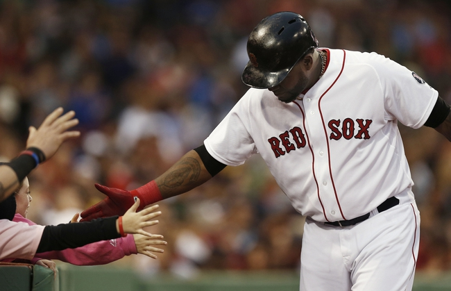 Jun 27, 2013; Boston, MA, USA;  Boston Red Sox player David Ortiz gets a high five from a young fan after scoring a run during the second inning against the Toronto Blue Jays at Fenway Park. Mandatory Credit: Winslow Townson-USA TODAY Sports