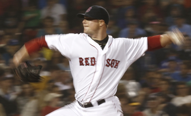 Jun 27, 2013; Boston, MA, USA;  Boston Red Sox starting pitcher Jon Lester delivers a pitch against the Toronto Blue Jays during the fifth inning at Fenway Park. Mandatory Credit: Winslow Townson-USA TODAY Sports