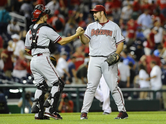 Jun 27, 2013; Washington, DC, USA; Arizona Diamondbacks relief pitcher Heath Bell (21) is congratulated by catcher Wil Nieves (27) after recording the final out against the Washington Nationals during the eleventh inning at Nationals Park.  Mandatory Credit: Brad Mills-USA TODAY Sports