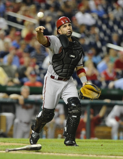 Jun 27, 2013; Washington, DC, USA; Arizona Diamondbacks catcher Wil Nieves (27) throws out Washington Nationals right fielder Jayson Werth (not shown) during the eleventh inning at Nationals Park.  Mandatory Credit: Brad Mills-USA TODAY Sports