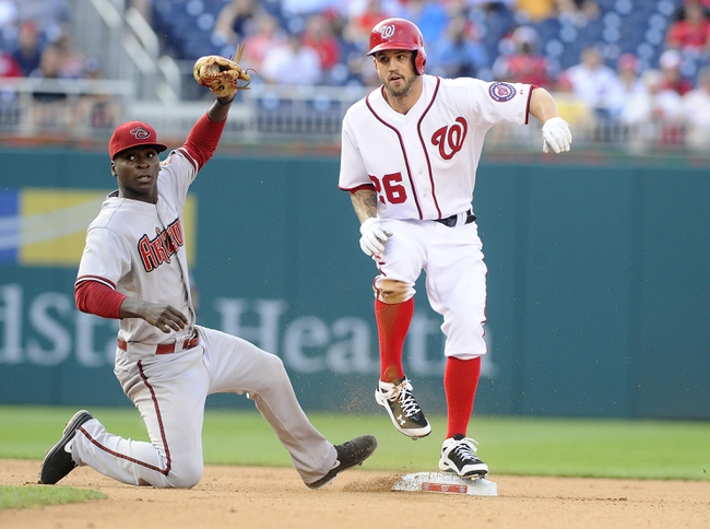 Jun 27, 2013; Washington, DC, USA; Washington Nationals second baseman Jeff Kobernus (26) beats the tag of Arizona Diamondbacks shortstop Didi Gregorius (1) to steal second base during the seventh inning at Nationals Park.  Mandatory Credit: Brad Mills-USA TODAY Sports