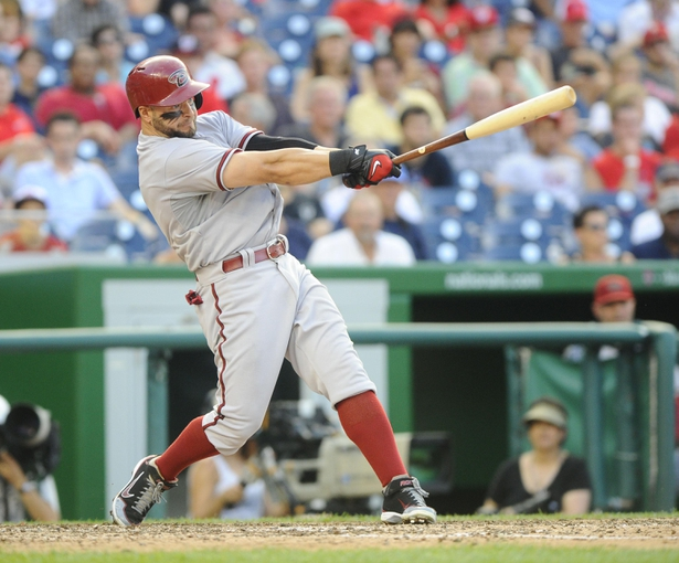 Jun 27, 2013; Washington, DC, USA; Arizona Diamondbacks right fielder Cody Ross (7) singles during the ninth inning against the Washington Nationals at Nationals Park.  Mandatory Credit: Brad Mills-USA TODAY Sports