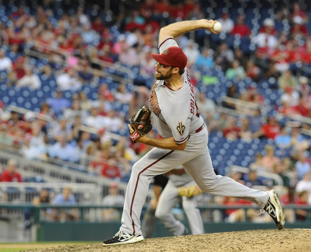 Jun 27, 2013; Washington, DC, USA; Arizona Diamondbacks relief pitcher Josh Collmenter (55) throws during the tenth inning against the Washington Nationals at Nationals Park. Mandatory Credit: Brad Mills-USA TODAY Sports
