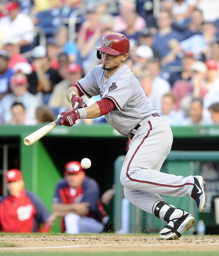 Jun 27, 2013; Washington, DC, USA; Arizona Diamondbacks center fielder Gerardo Parra (8) bunts and is called out for batters interference during the sixth inning against the Washington Nationals at Nationals Park.  Mandatory Credit: Brad Mills-USA TODAY Sports