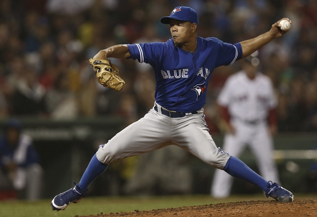 Jun 27, 2013; Boston, MA, USA;  Toronto Blue Jays relief pitcher Juan Perez delivers against the Boston Red Sox during the fourth inning at Fenway Park. Mandatory Credit: Winslow Townson-USA TODAY Sports