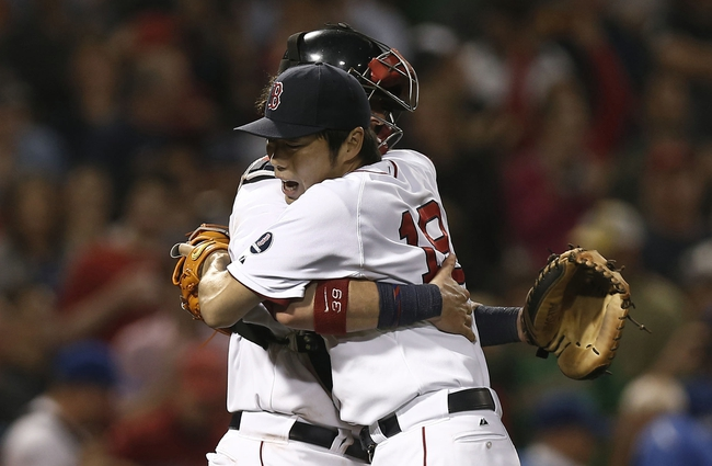 Jun 27, 2013; Boston, MA, USA;  Boston Red Sox relief pitcher Koji Uehara hugs catcher Jarrod Saltalamacchia after getting the final out of Boston's 7-4 win over the Toronto Blue Jays at Fenway Park. Mandatory Credit: Winslow Townson-USA TODAY Sports