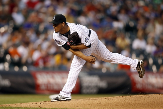 Jun 28, 2013; Denver, CO, USA; Colorado Rockies pitcher Jhoulys Chacin (45) delivers a pitch during the first inning against the San Francisco Giants at Coors Field. Mandatory Credit: Chris Humphreys-USA TODAY Sports