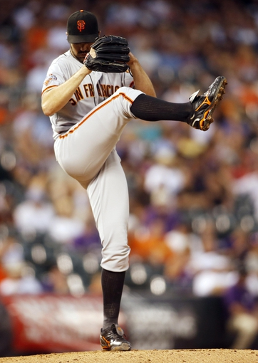 Jun 28, 2013; Denver, CO, USA; San Francisco Giants pitcher Barry Zito (75) delivers a pitch during the first inning against the Colorado Rockies at Coors Field.Mandatory Credit: Chris Humphreys-USA TODAY Sports