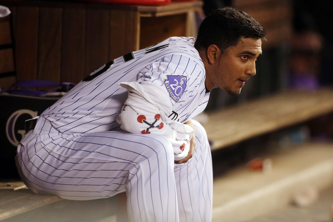 Jun 28, 2013; Denver, CO, USA; Colorado Rockies pitcher Jhoulys Chacin (45) watches from the dugout during the first inning against the San Francisco Giants at Coors Field. Mandatory Credit: Chris Humphreys-USA TODAY Sports