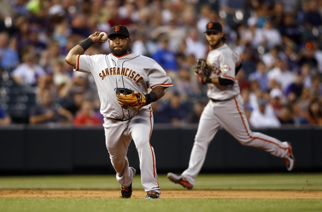 Jun 28, 2013; Denver, CO, USA; San Francisco Giants third baseman Pablo Sandoval (48) fields a ground ball during the first inning against the Colorado Rockies at Coors Field. Mandatory Credit: Chris Humphreys-USA TODAY Sports