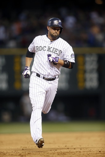 Jun 28, 2013; Denver, CO, USA; Colorado Rockies right fielder Michael Cuddyer (3) runs the bases after hitting a home run during the third inning against the San Francisco Giants at Coors Field. Mandatory Credit: Chris Humphreys-USA TODAY Sports