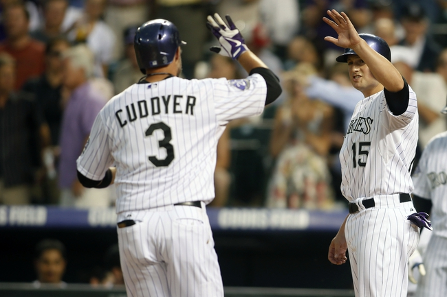 Jun 28, 2013; Denver, CO, USA; Colorado Rockies first baseman Jordan Pacheco (15) greets right fielder Michael Cuddyer (3) at home plate after Cuddyer hit a home run during the third inning against the San Francisco Giants at Coors Field. Mandatory Credit: Chris Humphreys-USA TODAY Sports