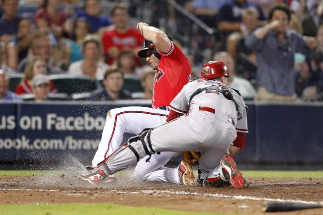 Jun 28, 2013; Atlanta, GA, USA; Atlanta Braves second baseman Dan Uggla (26) scores a run against the Arizona Diamondbacks in the eighth inning at Turner Field. The Braves defeated the Diamondbacks 3-0. Mandatory Credit: Brett Davis-USA TODAY Sports