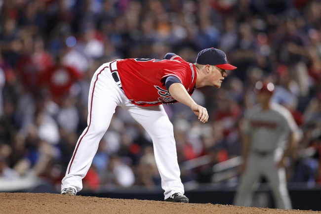 Jun 28, 2013; Atlanta, GA, USA; Atlanta Braves relief pitcher Craig Kimbrel (46) prepares to throw a pitch against the Arizona Diamondbacks in the ninth inning at Turner Field. The Braves defeated the Diamondbacks 3-0. Mandatory Credit: Brett Davis-USA TODAY Sports