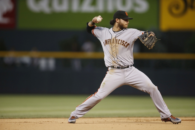 Jun 28, 2013; Denver, CO, USA; San Francisco Giants shortstop Brandon Crawford (35) fields a ground ball during the fourth inning against the Colorado Rockies at Coors Field. Mandatory Credit: Chris Humphreys-USA TODAY Sports