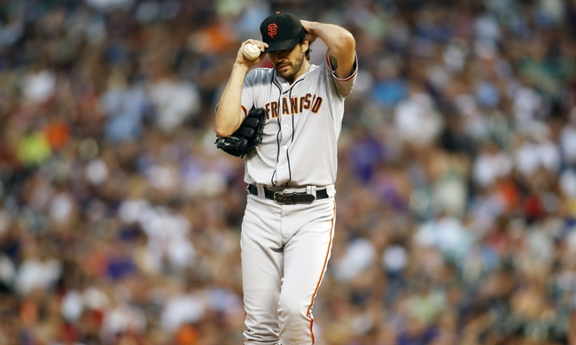 Jun 28, 2013; Denver, CO, USA; San Francisco Giants pitcher Barry Zito (75) reacts during the fifth inning against the Colorado Rockies at Coors Field.Mandatory Credit: Chris Humphreys-USA TODAY Sports